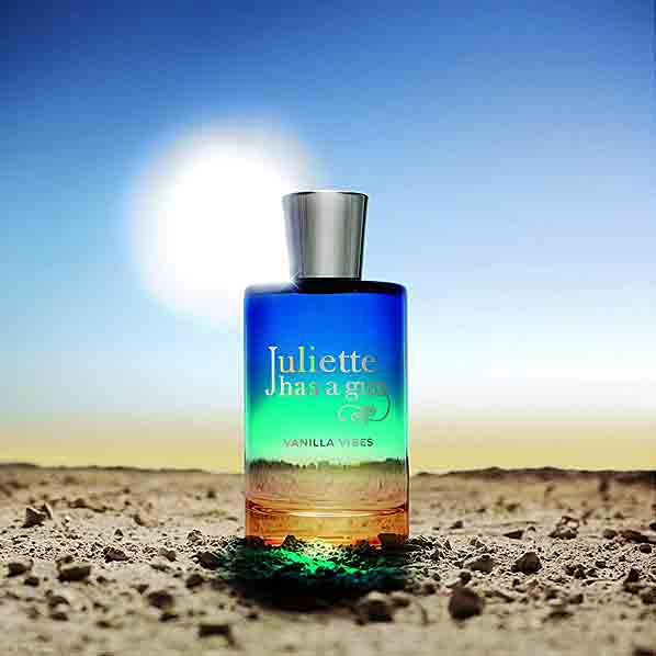Juliette Has a Gun Vanilla Vibes Eau de Parfum on desert with sun behind it