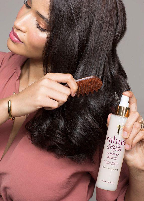 Rahua By Amazon Beauty Hydration Detangler + UV Barrier (193 ml) with woman combing hair