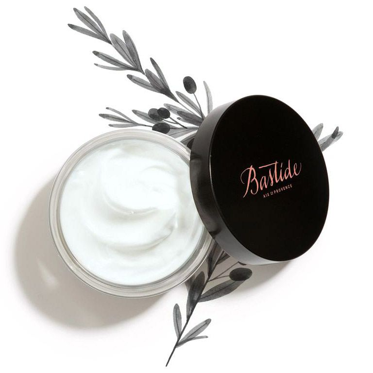 Bastide Corps A Corps Body Cream open jar with branches