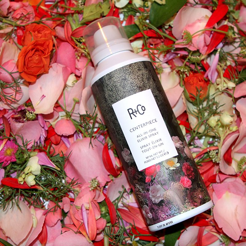 R+Co Centerpiece All-In-One Elixir Spray laying on flowers