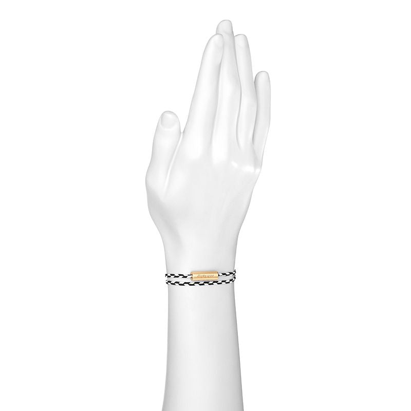 Diptyque Tam Dao Perfumed Bracelet shown on mannequin wrist