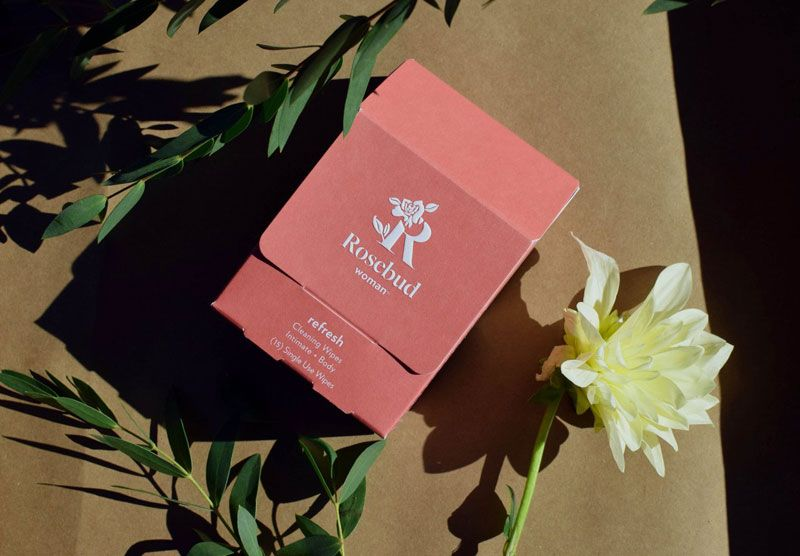 Rosebud Woman Refresh Intimate and Body Cleaning Wipes - beauty shot of box and flower