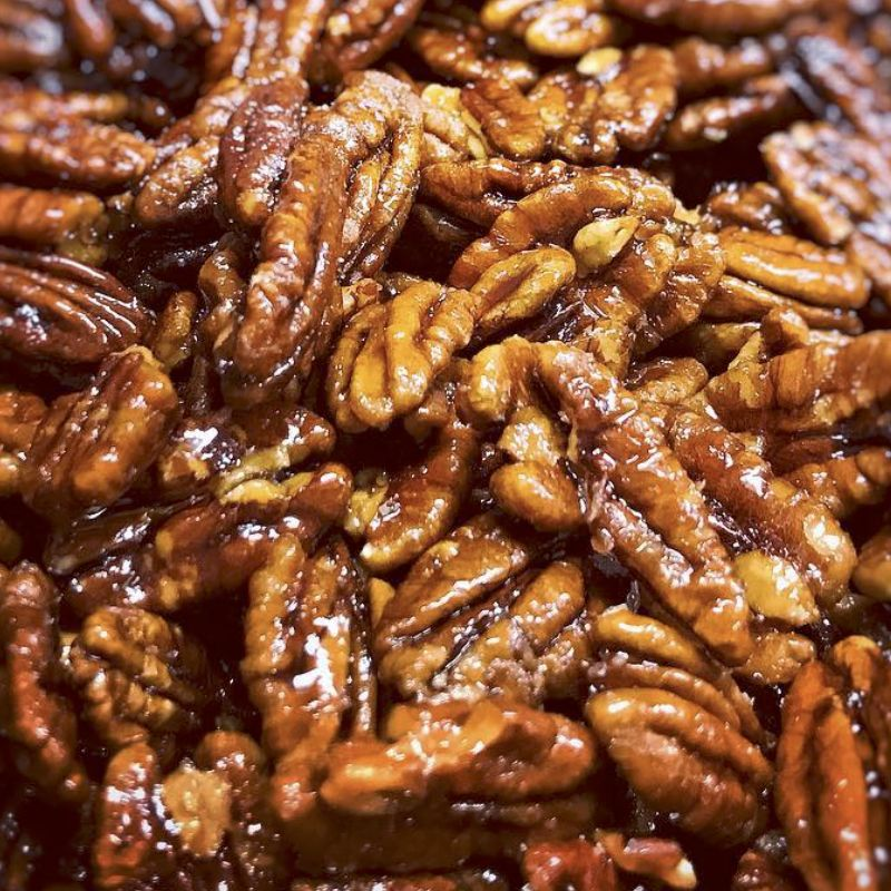 Close up of a small hand made batch of Nutkrack caramelized, buttery, toasted pecans with a touch of salt