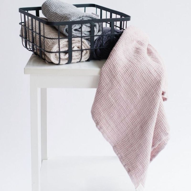 Linen Tales Waffle Hand Towel - Powder hanging from table