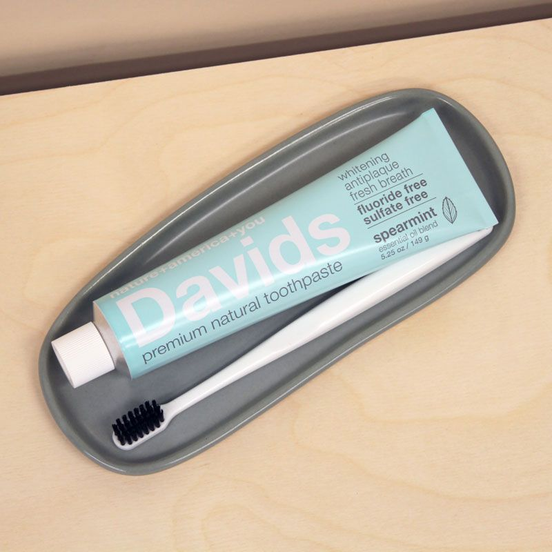 Davids Premium Natural Toothpaste - Spearmint (5.25 oz) in a tray with a toothbrush