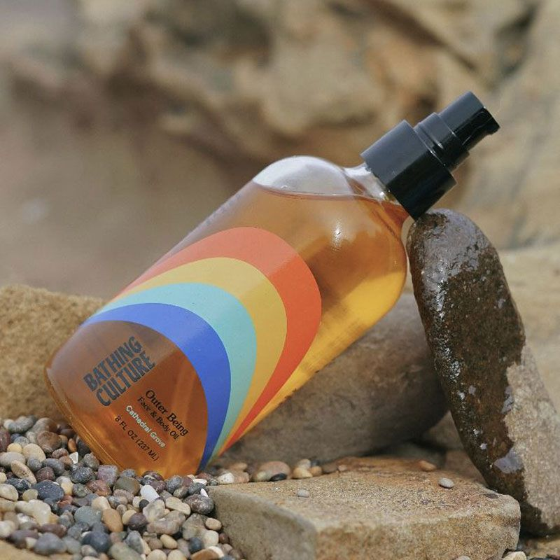 Bathing Culture Outer Being Face & Body Oil - lifestyle shot on the beach with rocks