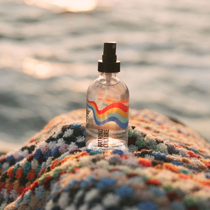 Bathing Culture Golden Hour Hydrosol - on towel in front of ocean