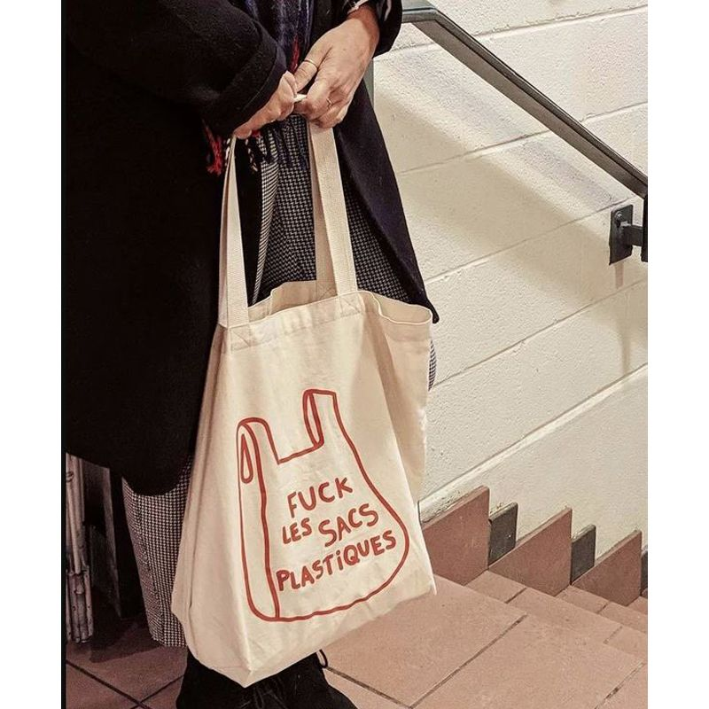 Mimi & August F&$! Plastique French Printed Cotton Tote Bag handles being held with two hands