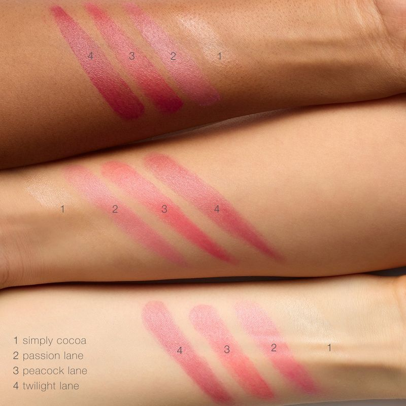 rms beauty tinted daily lip balm swatches shown on forearm of various models of light, medium and darker skin tones.