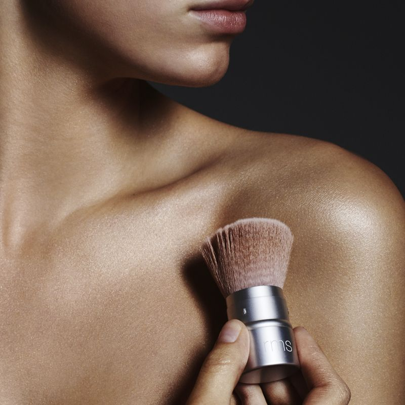 RMS Beauty Living Glow Face & Body Powder Brush being used by model
