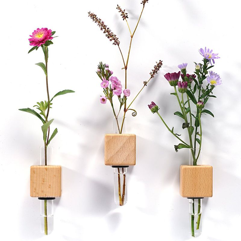 Lifestyle shot with 3 Funnyfish Smart Tube Vase Bright Cubes with flower stems in them
