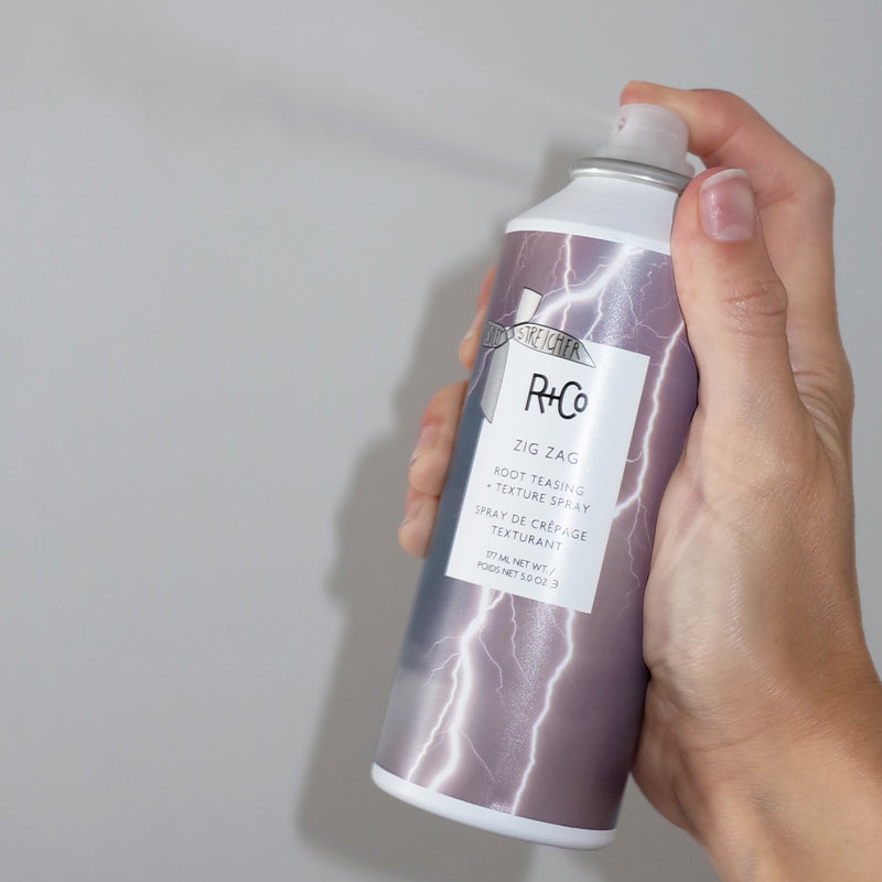 R+Co Zig Zag Root Teasing + Texture Spray (5 oz) being sprayed