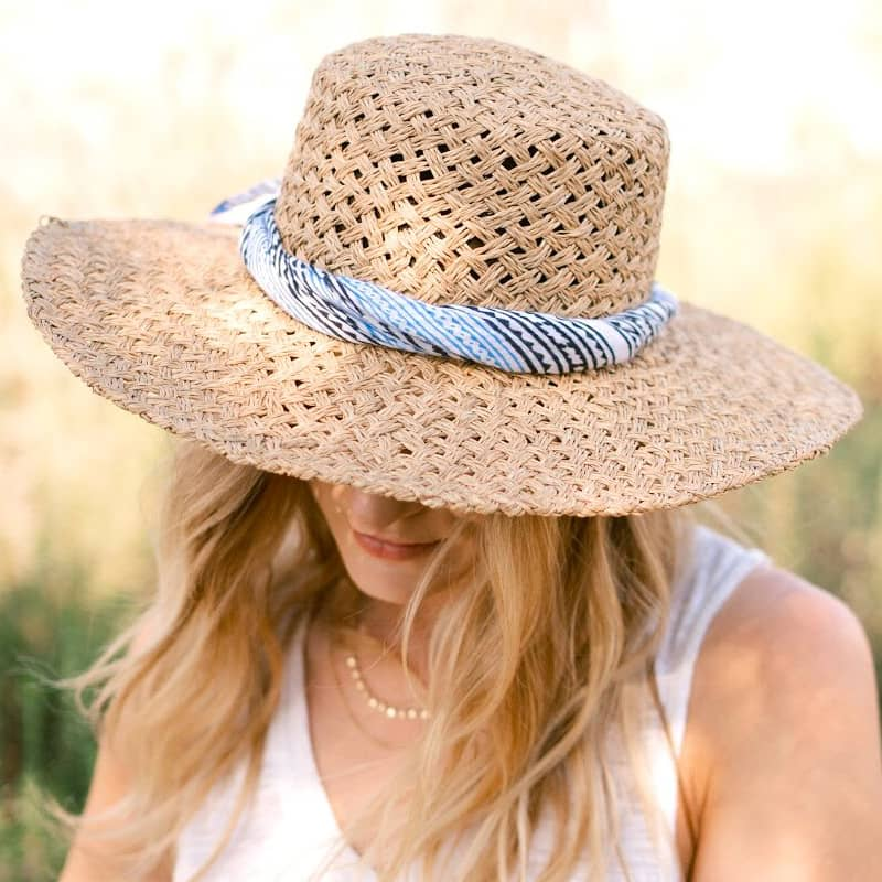 From Mila Aegean Bandana twisted and worn on band of straw hat of model