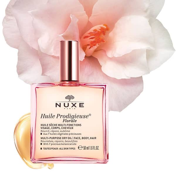 Nuxe Huile Prodigieuse Florale Multi-Purpose Dry Oil pictured with flower