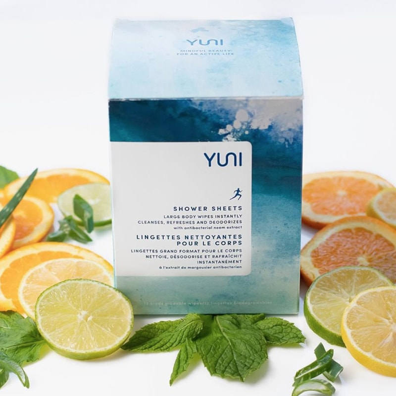 Yuni Beauty Neem Peppermint & Citrus Shower Sheets box with citrus fruit slices