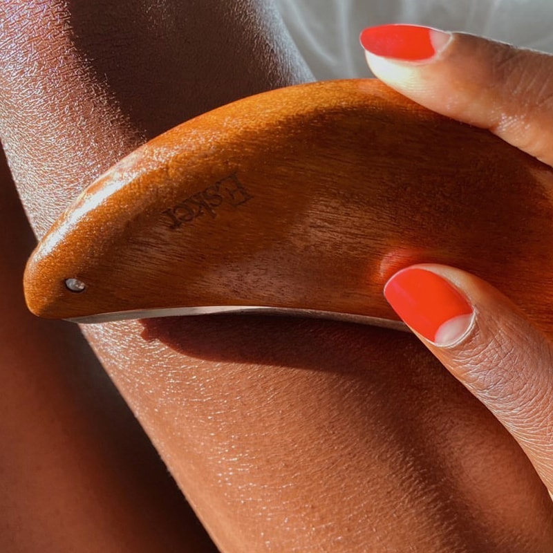 Esker Beauty Body Plane shown as close up on woman's arm