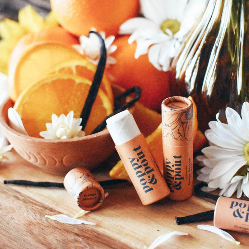 Poppy & Pout Orange Blossom Lip Balm beauty shot with ingredients