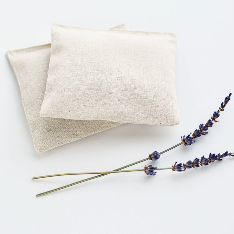 Minor Thread Organic Lavender Sachets in Natural Linen pictured with 2 sprigs of lavender