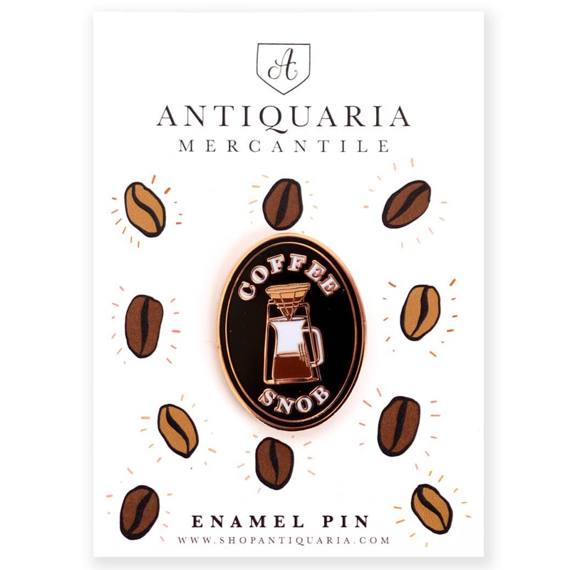 Antiquaria Coffee Snob Enamel Pin shown on the card as presented