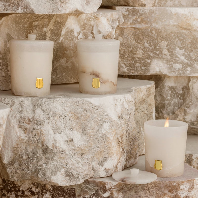 Cire Trudon Abd El Kader Alabaster Collection Candle showing 3 different Alabaster Candles on blocks of Alabaster