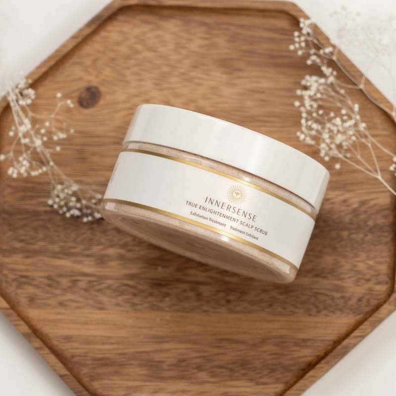 Innersense True Enlightenment Scalp Scrub - open jar surrounded by ingredients and flowers
