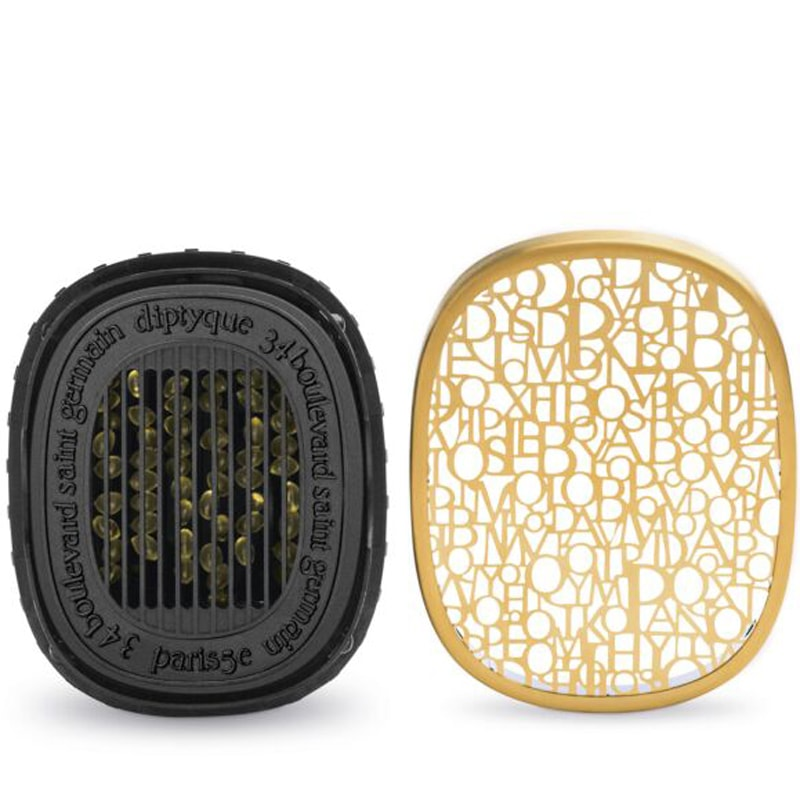 Diptyque Electric Diffuser Plug shown with cover off where to place scent cartridges (sold separately)