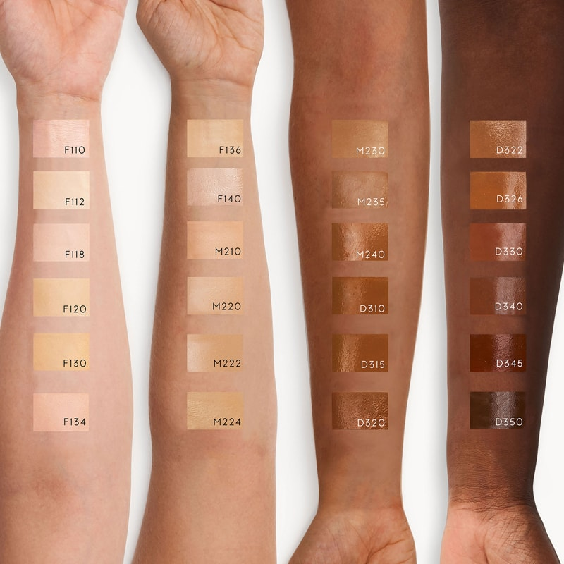 Kjaer Weis Invisible Touch Liquid Foundation color patches shown on various skin tones