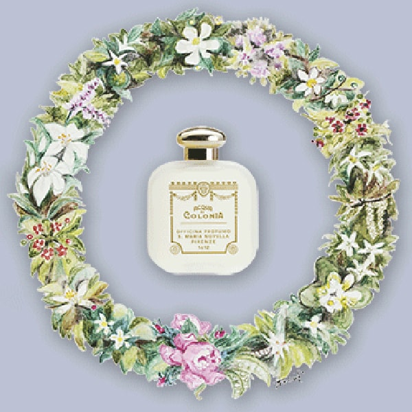 Santa Maria Novella Rosa Novella Cologne beauty shot of bottle inside wreath with flowers