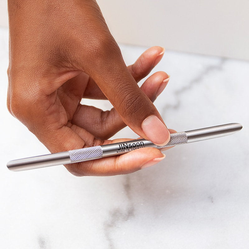 JINsoon HyperCare Cuticle Pusher + Reducer in Model's hand