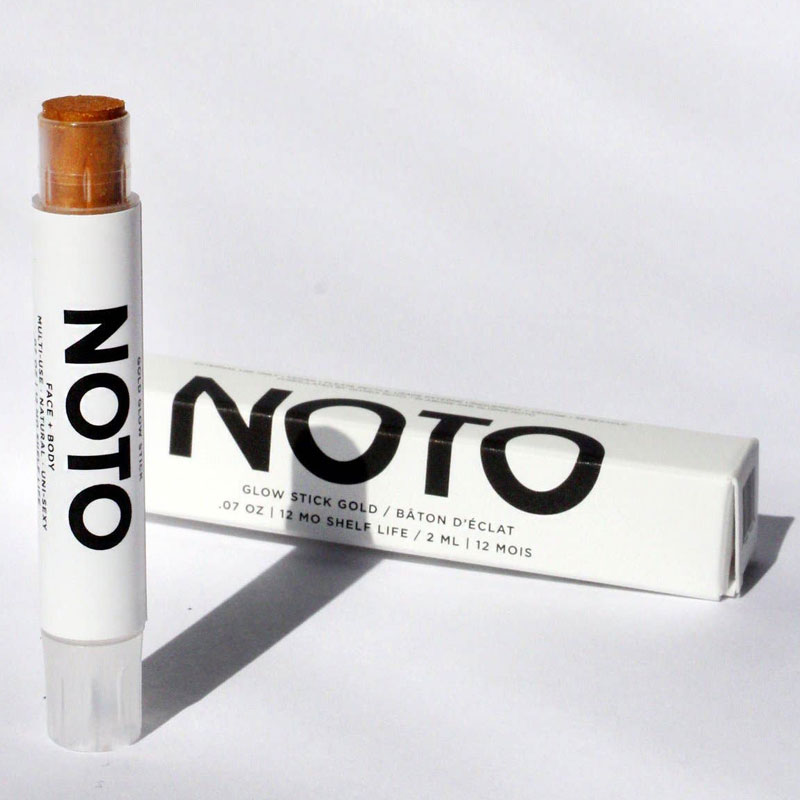NOTO Botanics Gold Glow Stick stick beside box