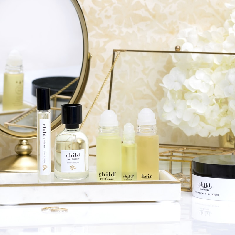 Lifestyle shot of Child Perfumes on a dresser (each sold separately)