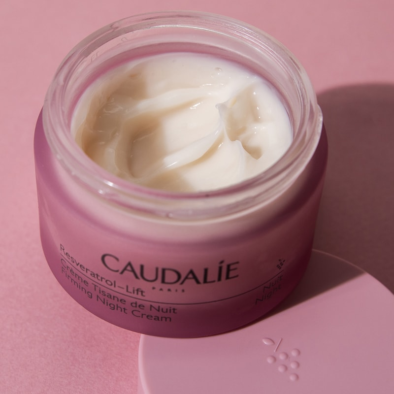 Caudalie Reservatrol-Lift Firming Night Cream beauty shot of open jar on pink background