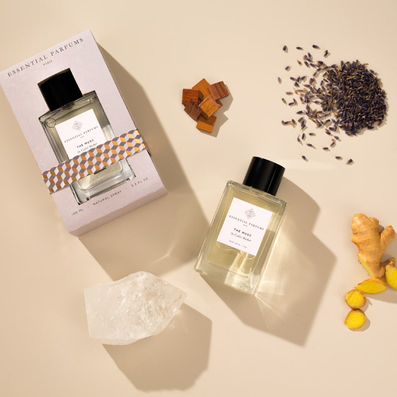 Essential Parfums The Musc Perfume by Calice Becker with note ingredients scattered - beauty shot