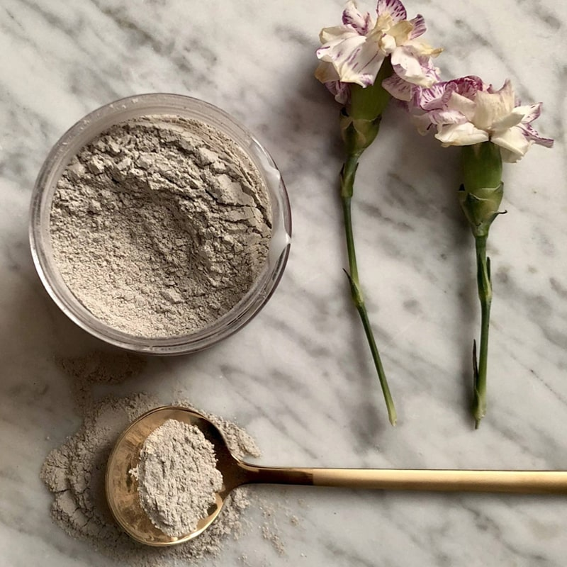 Athar'a Pure Multan Acne Healing Mask beauty shot with flowers and spoon