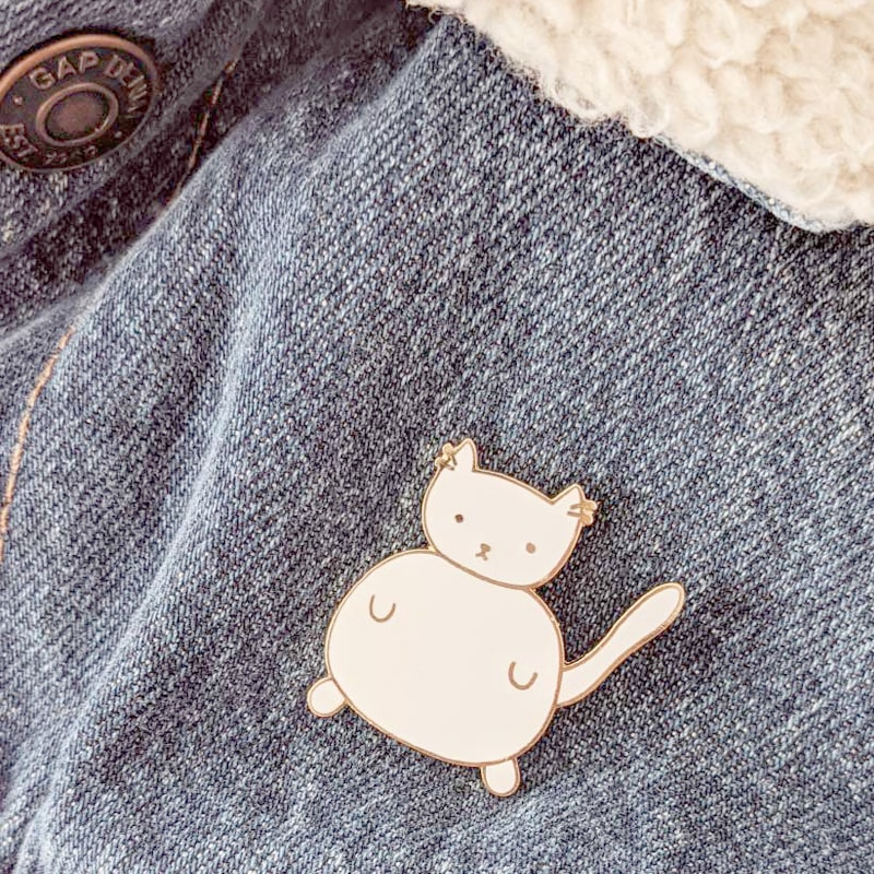 Mimi & August White Cat Enamel Pin shown on a denim jacket (not included)