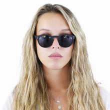 Maxine Scacchi in our simple round sunglasses