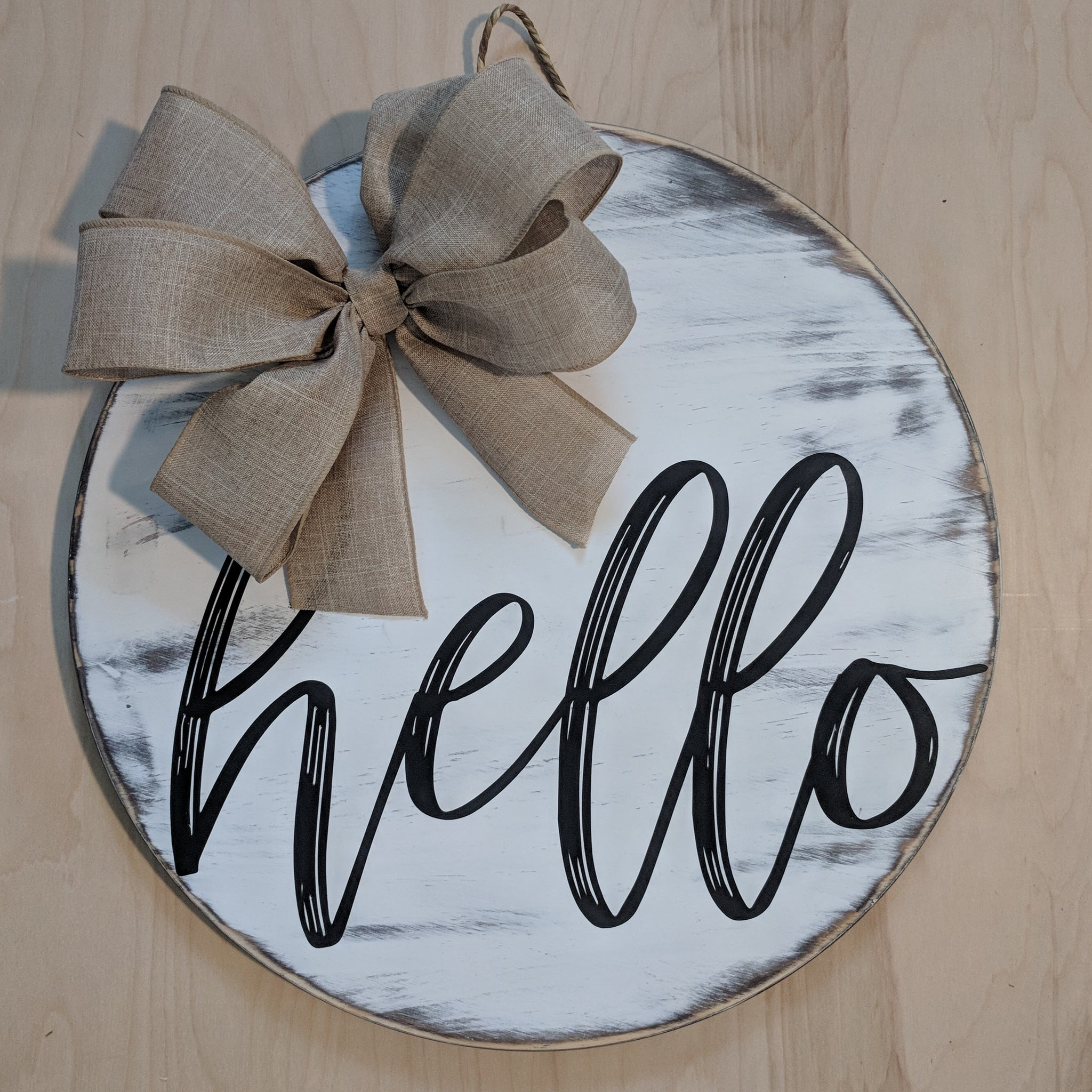 hello round wood door hanger with bow