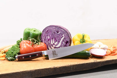 Dragon Fire 8.5 Inch Chef Knife Lifestyle with Veggies and Board
