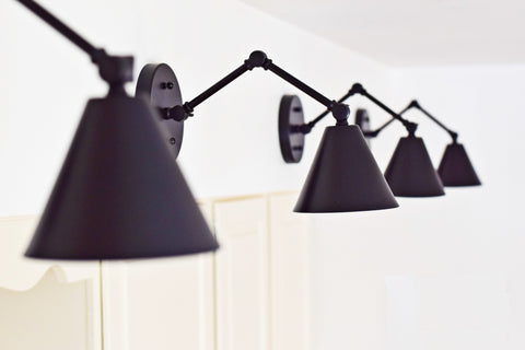 peak sconce in black