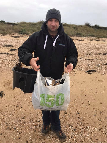 Neville Murray from Facebook collecting rubbish on the beach
