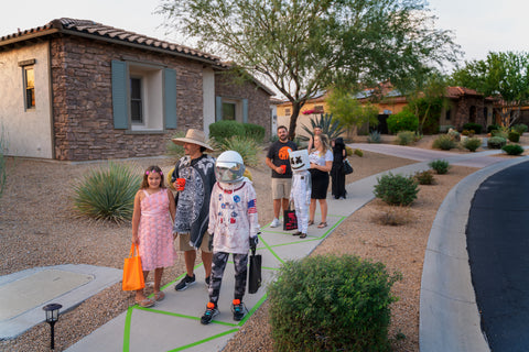 Families waiting in line to get candy on Halloween 2020