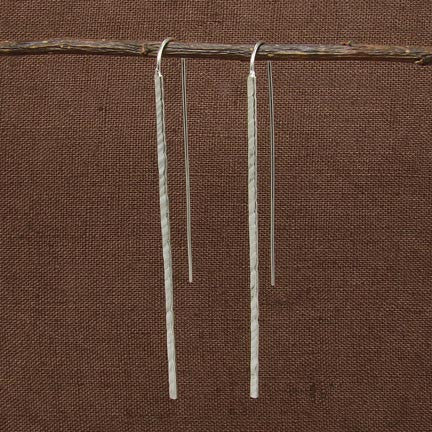 Handmade in Bali, Fair Trade, Hammered Icicle Sterling Silver Earrings, shown with brown wood background
