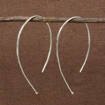 Handmade in Bali, Fair Trade, Hammered Curl Sterling Silver Earrings, shown with brown wood background