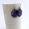 Handmade in Canada, Eco-Resin Wild Silk Aubergine Earrings, shown with white mug background