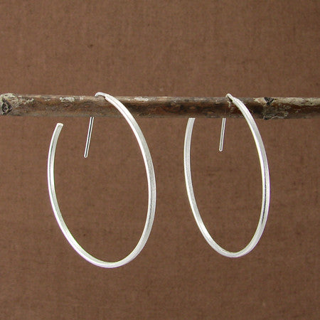 Handmade in Bali, Fair Trade, Brushed Hoop Sterling Silver Earrings, shown with brown wood background