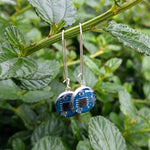 Handmade Turquoise Circuit Board Sterling Silver Long Earrings, shown with green plant background