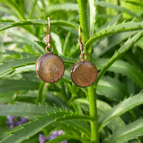 Handmade Circuit Board Short Copper Sterling Silver Earrings, shown with green plant background