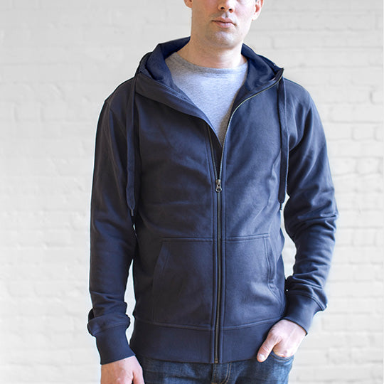 A man wearing a water-resistant Ably hoodie in navy.