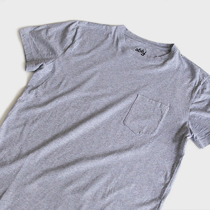 A heather gray, water resistant Ably pocket tee.