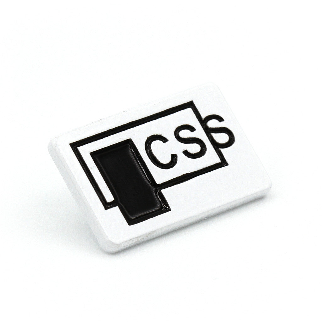 "A white enamel pin with the text ""CSS� printed on it, along with a rectangle overflowing out of another rectangle"